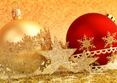 Christmas baubles and decorative ribbons on glittering background — 图库照片