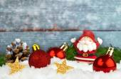 Christmas decorations in the snow on wooden background — Stok fotoğraf