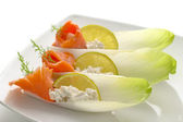 Smoked salmon and cream cheese on belgian endive — Stock Photo