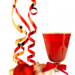 Red goblet, christmas baubles and satin ribbons on white background — Stock Photo #57814677