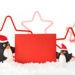Two penguins in the snow holding a red paper letter — Стоковое фото #57816465