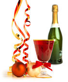 Red goblet, christmas balls and satin ribbons on white background — Stockfoto