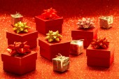 Heap of gift boxes on glitter background — Stock Photo