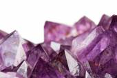 Close up of amethyst crystals on white background — Stock Photo