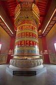 Colorful prayer wheel isolated inside buddhist temple — Стоковое фото