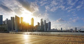 Central business district of Singapore and promenade at sunset — Stock Photo