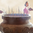 Incense sticks burning outside of buddhist temple — Stock Photo #66950329