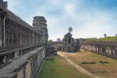 Ancient stone building in angkor under blue sky — Foto de Stock