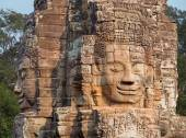 Buddha head carved in stone at Bayon — Stok fotoğraf