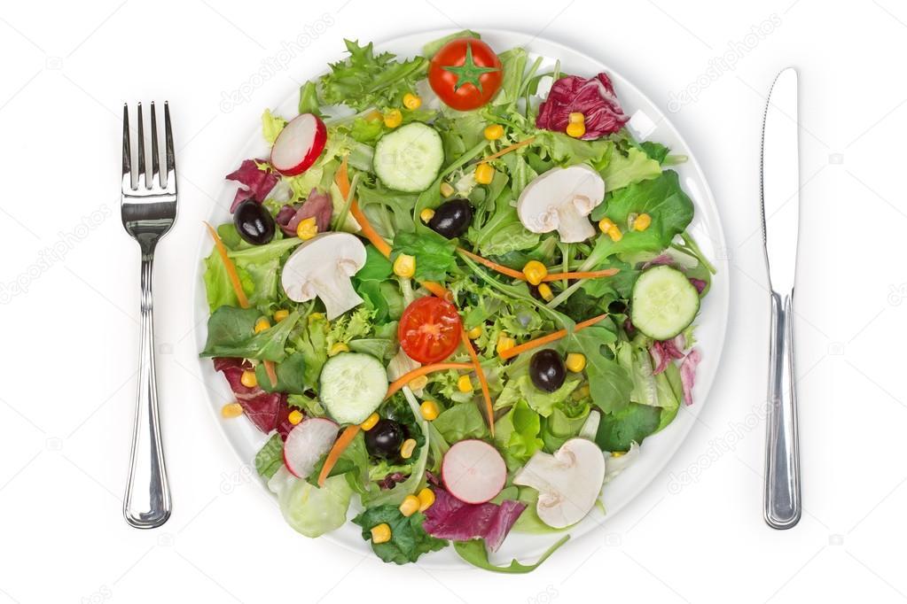 Vista superior de un plato de ensalada tenedor y cuchillo for Plato tenedor y cuchillo