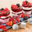Dessert with berries, soft fruit and Christmas decorations — Stock Photo #76186193