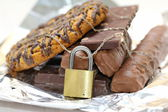 Chocolate and biscuits locked — Stock fotografie
