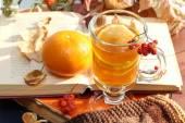 Still life with hot tea in autumn decoration — Stock Photo