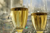 Glasses of champagne with christmas decoration — Stock Photo