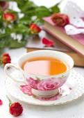 Still life with tea, books and roses — Fotografia Stock