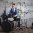 The man plays drums — Stock Photo #62631439