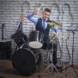 The man plays drums — Stock Photo #62631455