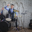 The man plays drums — Stock Photo #62631475