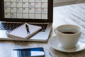 Checking monthly activities in the calendar in the laptop — Stock Photo