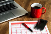 Organizing monthly activities in the calendar — Stock Photo
