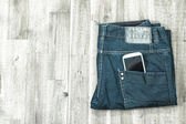 Jeans with cellphone — Stock Photo