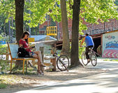 Reading a book during the bicycle ride — Stock Photo