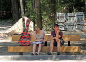 Two on the park bench — Stock Photo