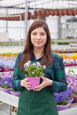 Young smiling female florist — Stock Photo