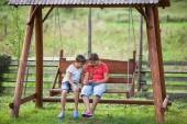 Children with tablet outdoors — Foto Stock