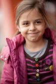 Close up of beautiful smiling little girl — Stock Photo