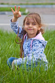 Little girl with pile in hand — Stock Photo