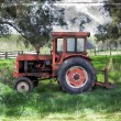 Old vintage tractor in rural setting — Stock Photo #52305653