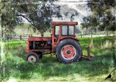Old vintage tractor in rural setting — Photo