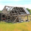 Old run falling down and ruined country wooden house — Stock Photo #60284735