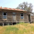 Old run down country wooden house — Stock Photo #60284805
