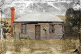 Old rundown country house with grungy texture — Stock Photo