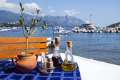 Served table on sea beach restaurant of Budva, Montenegro. — Stock Photo