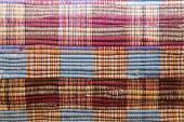 Textile background (homespun rug) — Stock Photo
