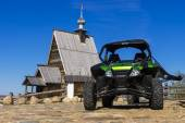 RLES, RUSSIA - MAY 9: the Arctic Cat Wildcat ATV - against old w — Stock Photo