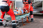 Woman after accident on the stretcher — Stock Photo