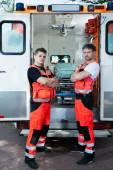 Male paramedics outside the ambulance — Foto Stock