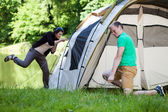 Couple trying to pitch a tent — Stockfoto