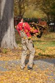 Carring autumn leaves — Stock Photo