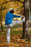 Man is stretching himself — Stock Photo