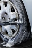 Wheel cleaning on a car wash — Stock Photo