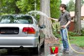 Tired man cleaning car — Stock Photo