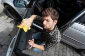 Man cleaning a car — Foto Stock