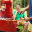 Friends during grilling on a barbecue — Stock Photo #52254863