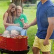 Young friends during barbecue — Stock Photo #52254893