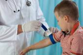 Little boy before taking blood sample — Stock Photo